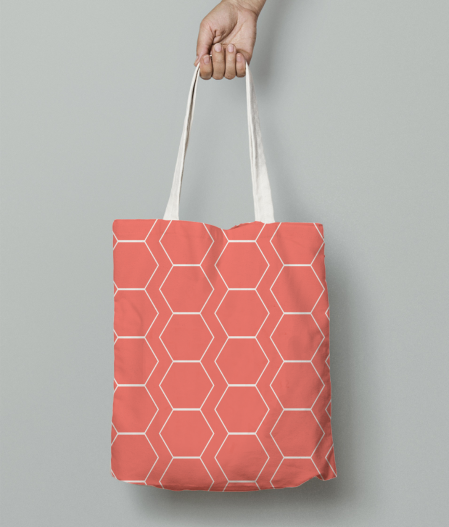 White hexagon living coral pattern tote bag front