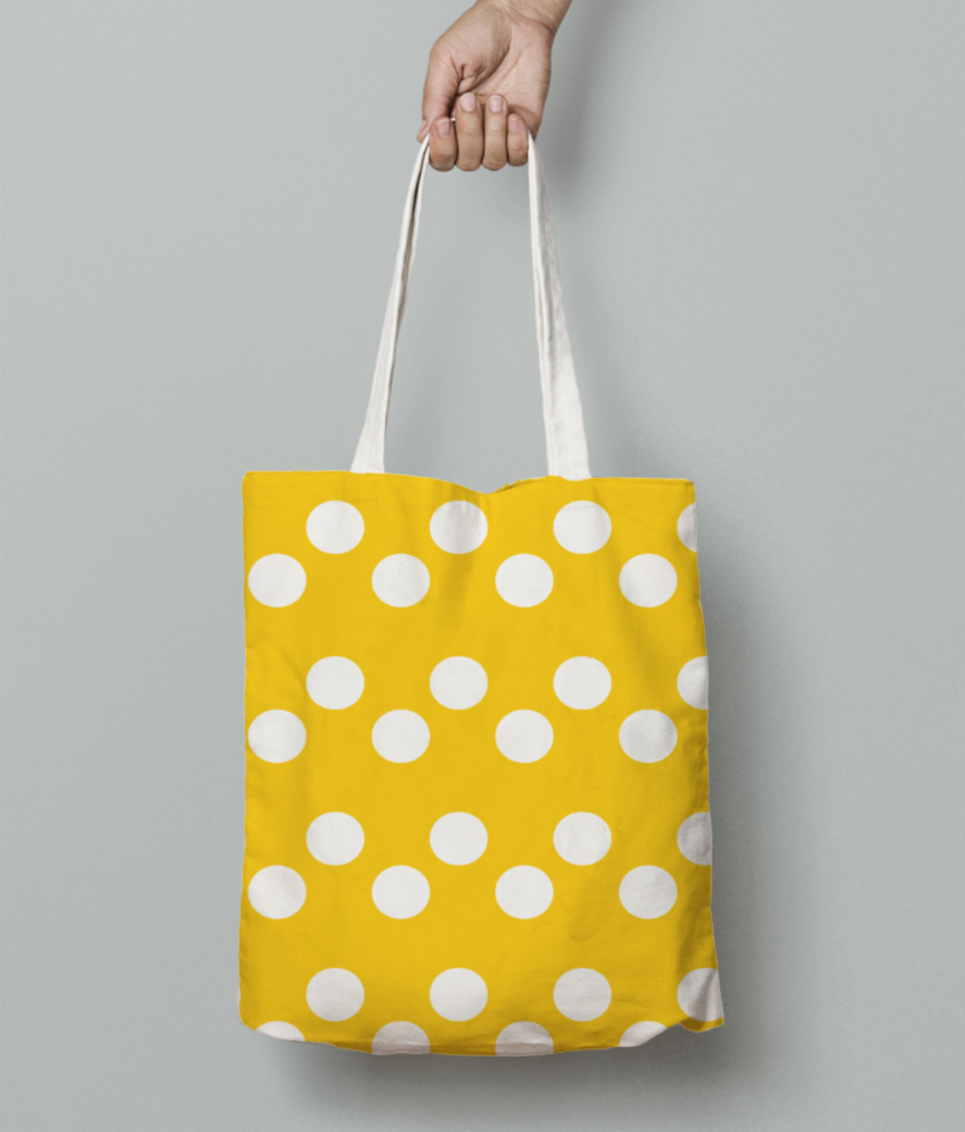 Yellow white dots pattern tote bag front
