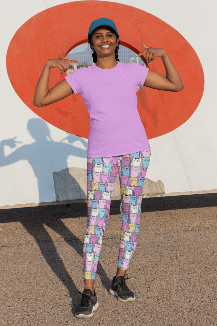 Activewear mockup featuring a smiling woman wearing a tee and leggings 31350