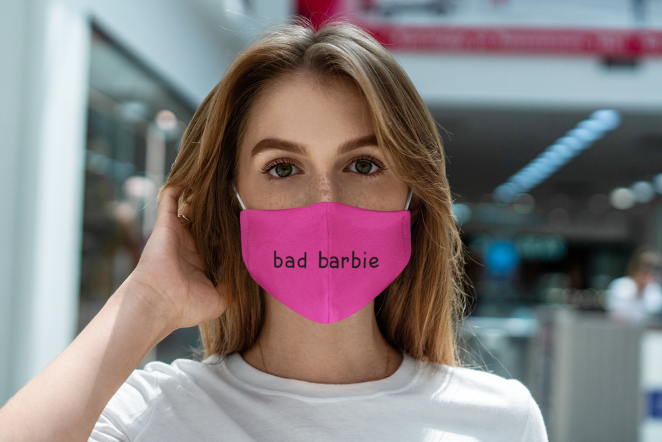 Mockup featuring a serious young woman wearing a sublimated face mask 4893 el1