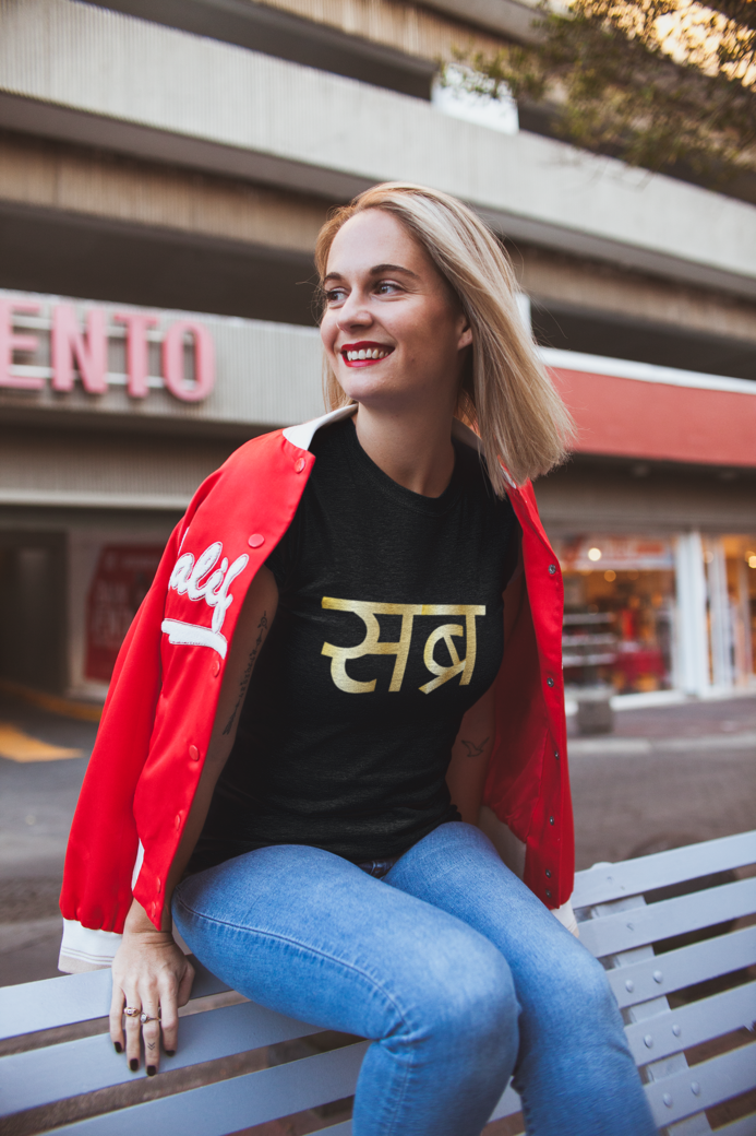 T shirt mockup of a blonde woman in a commercial city area 23956